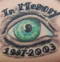 Green eyes memorial tattoo