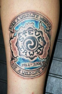 Symbol with motto memorial tattoo
