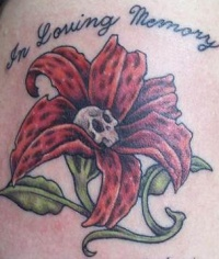 Dead flower in loving memory tattoo