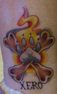 Xero dog paw with crossed bones memorial tattoo